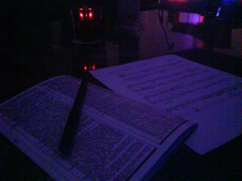 Writing lyrics in the club by candlelight
